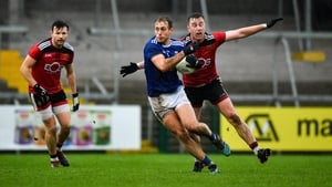 Pádraig Faulkner of Cavan in action against Paul Devlin of Down