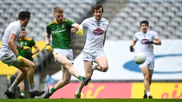 Mathew Costello of Meath scores his side's first goal despite the attention of Paddy Brophy of Kildare