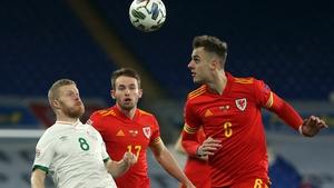 Daryl Horgan (L) closes in on Wales' defender Joe Rodon