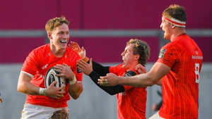 Mike Haley celebrates with team-mates Craig Casey and Gavin Coombes after scoring the second Munster try