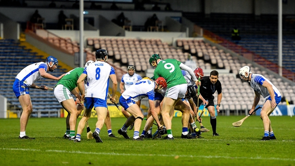 Limerick and Waterford players contest possession at Semple Stadium