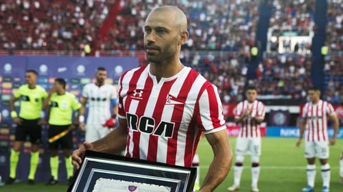 Mascherano poses with a plaque given to him by San Lorenzo soccer club to honor his career in January