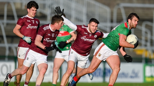 Aidan O'Shea of Mayo in action against Damien Comer of Galway during the Connacht final