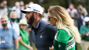 Dustin Johnson walks with fiancée Paulina Gretzky after winning the Masters