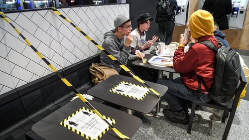 Tables at a fast food restaurant in Stockholm are taped off to allow for social distancing (file image)