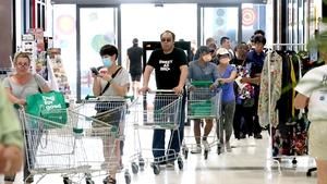 People queue at a supermarket in West Torrens, Adelaide, ahead of the lockdown