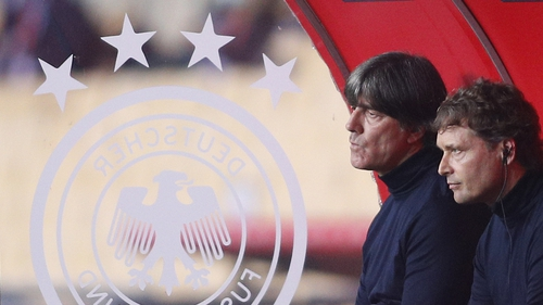 German head coach Joachim Loew (L) and assistant coach Marcus Sorg watch their team slump to a 6-0 loss