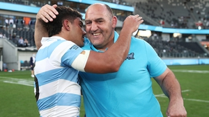 Argentina head coach Mario Ledesma (R) celebrates with Santiago Carreras after beating New Zealand