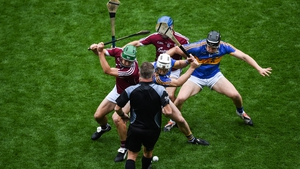 David Burke (L) and Johnny Coen of Galway contest the throw in against Brendan Maher (L) and Dan McCormack of Tipperary in 2017