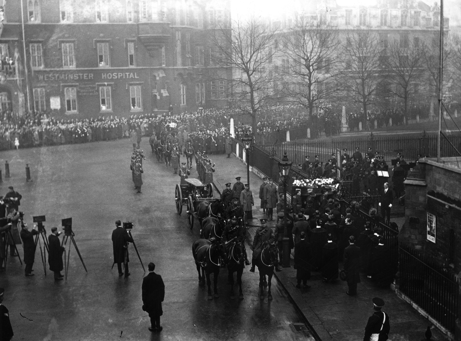 Image - A funeral procession for the British officers killed in Dublin on Bloody Sunday arrives at Westminster Abbey in London. (Photo by A. R. Coster/Topical Press Agency/Getty Images)