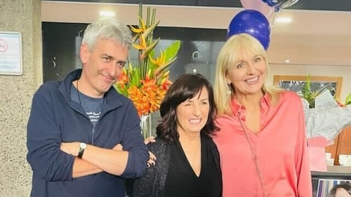 David McCullagh and Miriam O'Callaghan pose with their colleague (C) on her final day at work