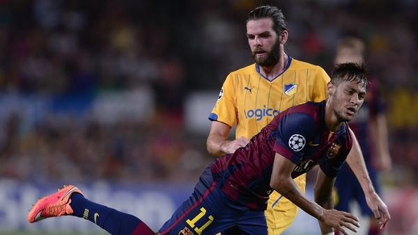 Neymar (L) falls in front of Cillian Sheridan during APOEL's September 2014 game against Barcelona