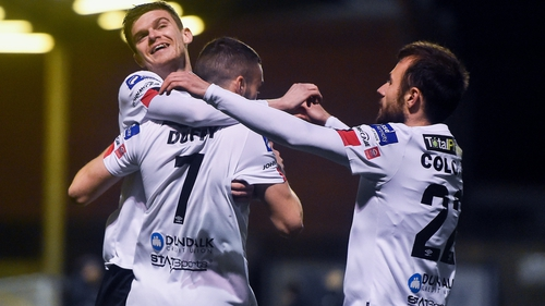 Sean Gannon and Stefan Colovic celebrate with Michael Duffy after his early opener at Dalymount Park