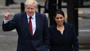 British Prime Minister Boris Johnson has stood by embattled Home Secretary Priti Patel