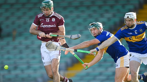 Brian Concannon of Galway in action against Cathal Barrett and Brendan Maher of Tipperary