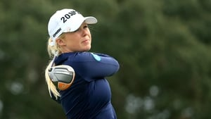 Stephanie Meadow of Northern Ireland hits her tee shot on the 14th hole