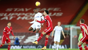 Nampalys Mendy of Leicester City rises with Curtis Jones