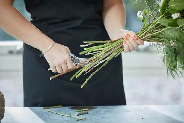 Cut long stems to size (Interflora/PA)