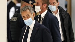 Former French president Nicolas Sarkozy arrives at court for his trial on corruption charges