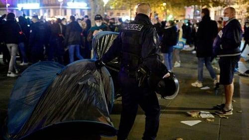 Officers used tear gas to dismantle the camp at Place de la République in Paris