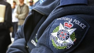 Victoria police outside Melbourne Magistrates Court during the trial of Abdul NacerBenbrika in 2006