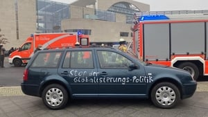'Stop Globalisation Politics' is seen written on the side of the car