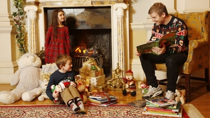 Gordon D'Arcy reading to Jack Siron (age 4) and Ava Murphy (age 5) in Farmleigh House where some Dublin Book Festival Christmas Bedtime Stories were filmed