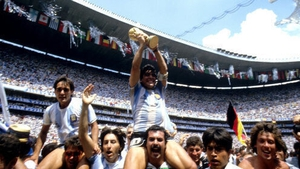 The Argentina captain holds the World Cup trophy aloft