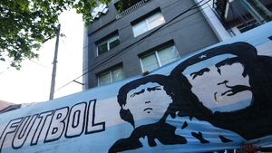 An Argentina flag depicting Maradona Che Guevara hangs outside of clinic in where the former was recently treated for a clot on his brain