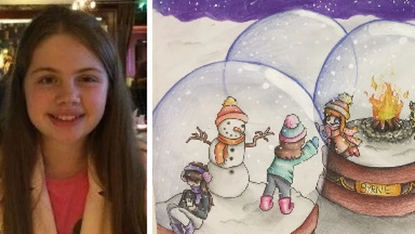 Abby O'Reilly's winning entry, showed groups of people celebrating Christmas in three snow globes, together but apart