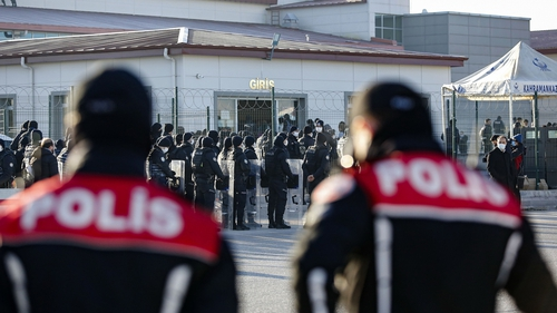 Turkish police officers stand guard outside a Turkish court in Ankara