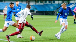 Nicolas Pepe (C) vies for the ball with Molde's Etzaz Hussein (L) a