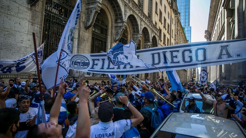 Fans of Diego Maradona gather in front of the funeral chapel installed in the Casa Rosada in Buenos Aires