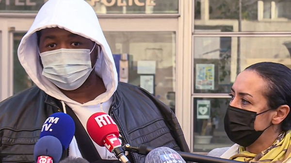 French music producer 'Michel' talks to the media next to his lawyer