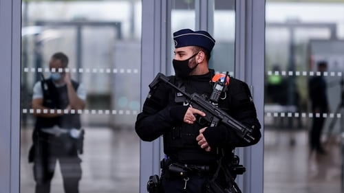 Belgian police officers stand guard at the entrance to Antwerp courthouse