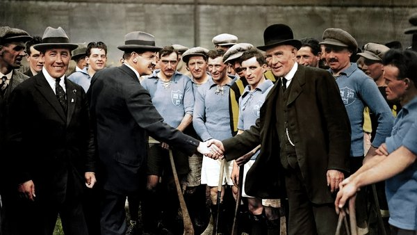 Michael Collins shakes hands with