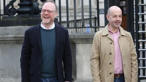 Trevor Birney (L) and Barry McCaffrey outside Belfast High Court today