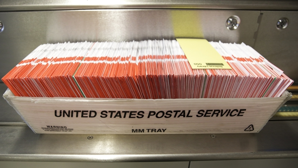 A box of ballots pictured in a US Postal Service box on Election Day