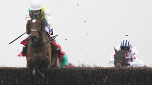 Tom Scudamore and Cloth Cap clear the last to win The Ladbrokes Trophy Chase at Newbury.
