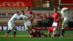 England's winger Jonny May is tackled by Welsh lock Alun Wyn Jones