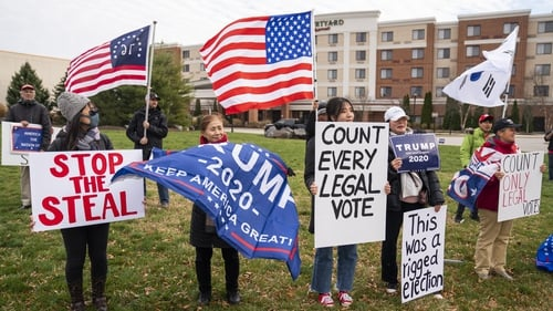 Supporters of Donald Trump outside a public hearing in Gettysburg, Pennsylvania