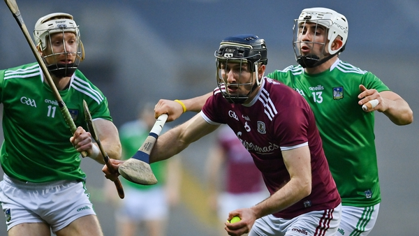 Padraic Mannion of Galway in action against Limerick's Cian Lynch and Aaron Gillane.