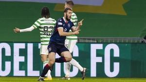 Ross County's Alex Iacovitti celebrates making it 2-0 at Celtic Park