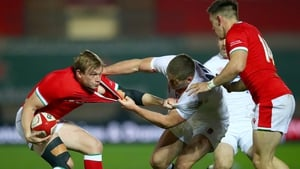 Nick Tompkins is tackled by Owen Farrell at Parc y Scarlets.
