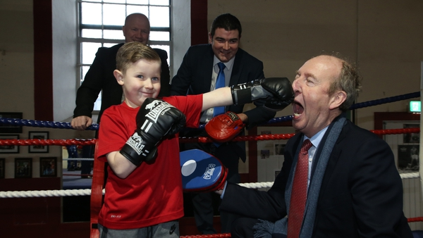 King of the photo op: At Arbour Hill Boxing Club, Dublin, announcing the 2017 Sports Capital Grants. Minister of State Brendan Griffin watches as a young member of the club, Kalvin Keenan, lands a painful punch