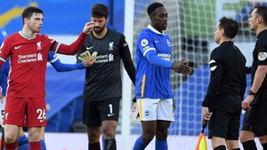 Andy Robertson (left) fell foul of VAR during Liverpool's draw with Brighton