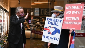 Michael Gove gestures as he passes anti-Brexit demonstrator Steve Bray in London
