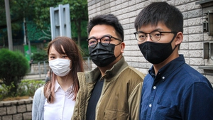 (L-R) Anges Chow, Ivan Lam and Joshua Wong were jailed for roles in anti-government rally