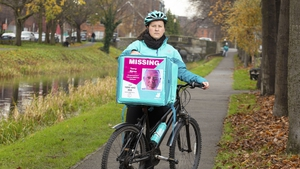 Deliveroo rider with a food delivery bag showing a picture of Terry Byrne who was 45 when he disappeared from his home on 7 February 2020 in Dunboyne, Co. Meath.