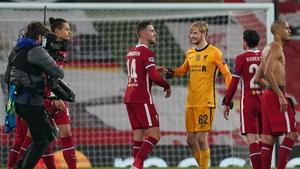 A beaming Caoimhin Kelleher celebrates Liverpool's win with captain Jordan Henderson